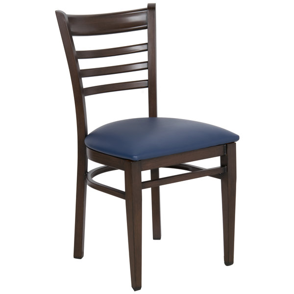 Preassembled Lancaster Table & Seating Spartan Series Metal Ladder Back Chair with Walnut Wood Grain Finish and Navy Vinyl Seat