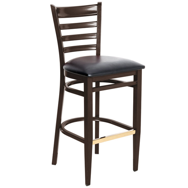 Knocked Down Lancaster Table & Seating Spartan Series Bar Height Metal Ladder Back Chair with Walnut Wood Grain Finish and Black Vinyl Seat
