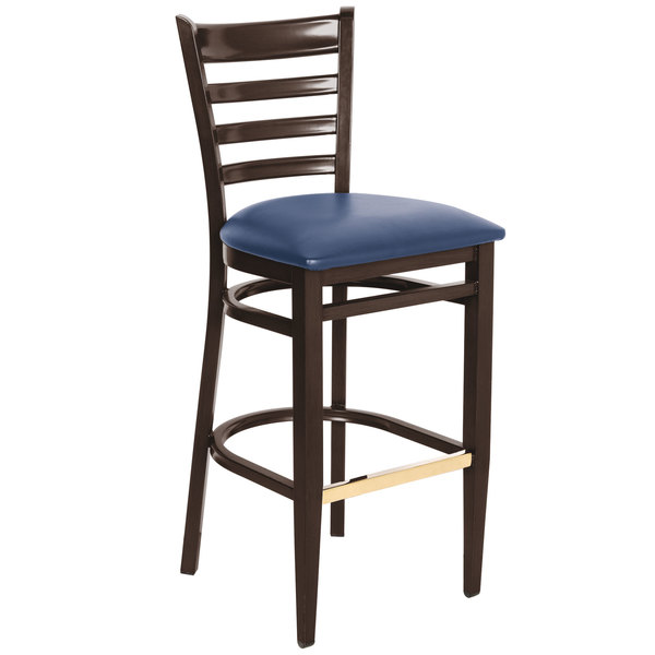 Preassembled Lancaster Table & Seating Spartan Series Bar Height Metal Ladder Back Chair with Walnut Wood Grain Finish and Navy Vinyl Seat