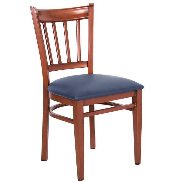 Preassembled Lancaster Table & Seating Spartan Series Metal Slat Back Chair with Mahogany Wood Grain Finish and Navy Vinyl Seat