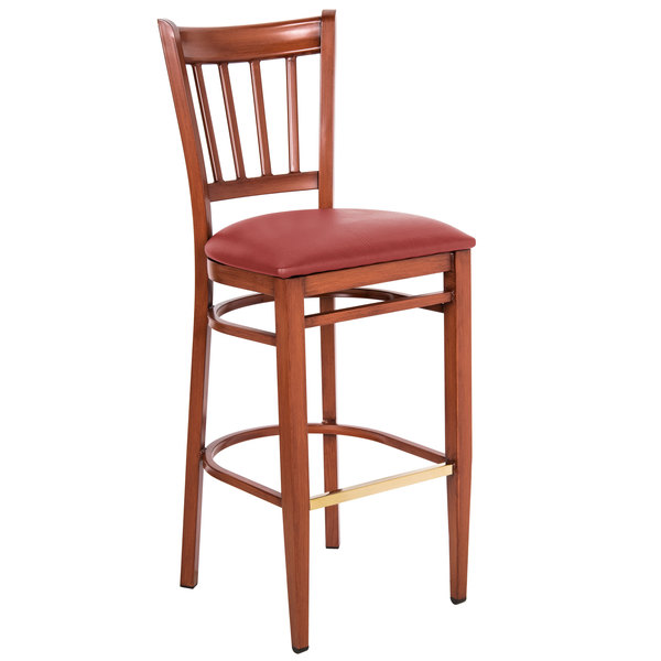 Preassembled Lancaster Table & Seating Spartan Series Bar Height Metal Slat Back Chair with Mahogany Wood Grain Finish and Red Vinyl Seat