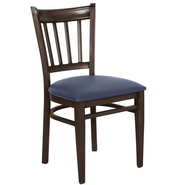 Preassembled Lancaster Table & Seating Spartan Series Metal Slat Back Chair with Walnut Wood Grain Finish and Navy Vinyl Seat