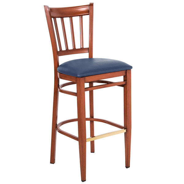 Preassembled Lancaster Table & Seating Spartan Series Bar Height Metal Slat Back Chair with Mahogany Wood Grain Finish and Navy Vinyl Seat