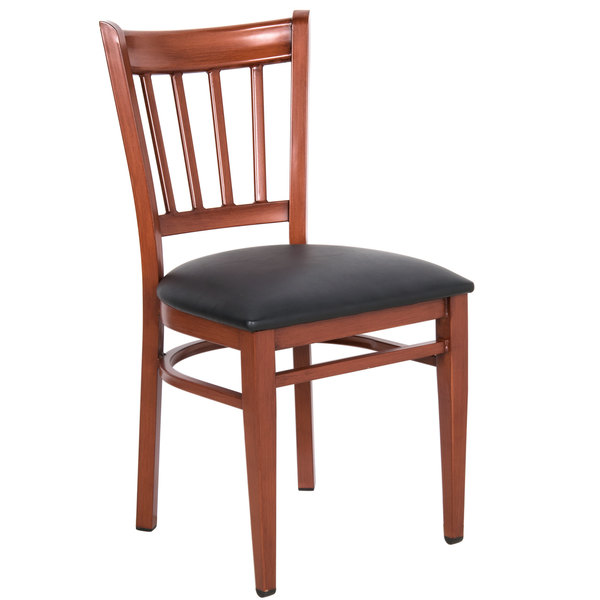 Preassembled Lancaster Table & Seating Spartan Series Metal Slat Back Chair with Mahogany Wood Grain Finish and Black Vinyl Seat