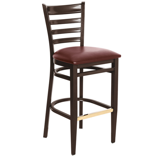 Lancaster Table & Seating Spartan Series Bar Height Metal Ladder Back Chair with Walnut Wood Grain Finish and Burgundy Vinyl Seat