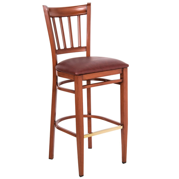 Knocked Down Lancaster Table & Seating Spartan Series Bar Height Metal Slat Back Chair with Mahogany Wood Grain Finish and Burgundy Vinyl Seat