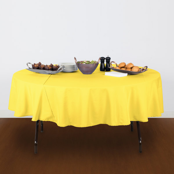 90 Round Yellow 100 Polyester Hemmed Cloth Table Cover