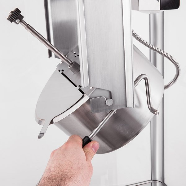 Person using a stainless steel kettle