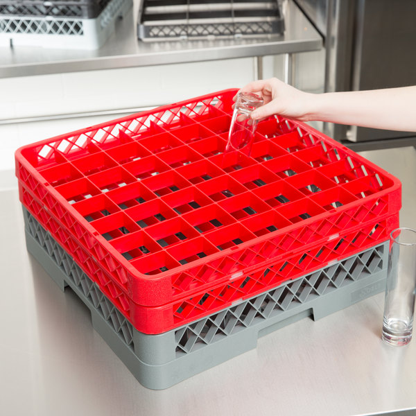Gray plastic glass rack with 2 red extenders on equipment table