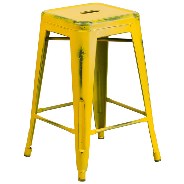 Flash Furniture ET-BT3503-24-YL-GG Distressed Yellow Stackable Metal Counter Height Stool with Drain Hole Seat Main Image 1