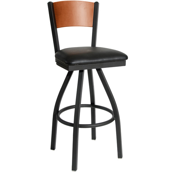 "BFM Seating 2150SBLV-CHSB Dale Sand Black Metal Swivel Bar Height Chair with Cherry Finish Wooden Back and 2"" Black Vinyl Seat Main Image 1"