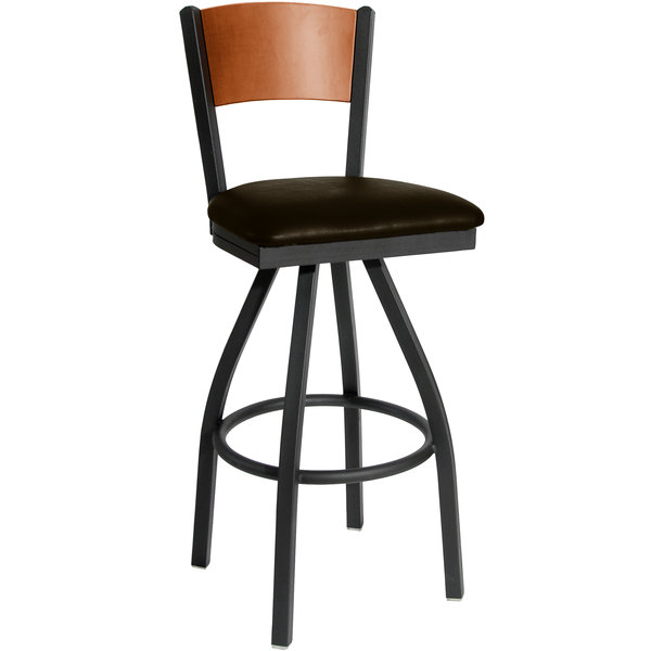 "BFM Seating 2150SDBV-CHSB Dale Sand Black Metal Swivel Bar Height Chair with Cherry Finish Wooden Back and 2"" Dark Brown Vinyl Seat Main Image 1"