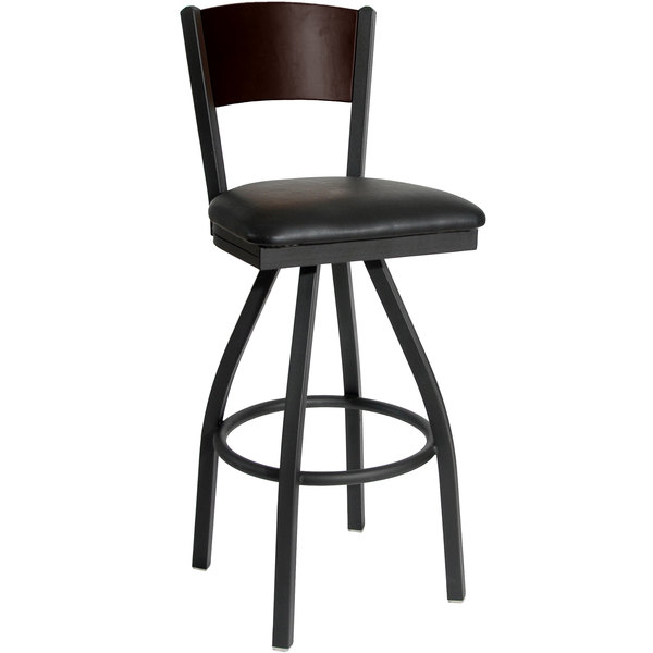 """BFM Seating 2150SBLV-WASB Dale Sand Black Metal Swivel Bar Height Chair with Walnut Finish Wooden Back and 2"""" Black Vinyl Seat Main Image 1"""