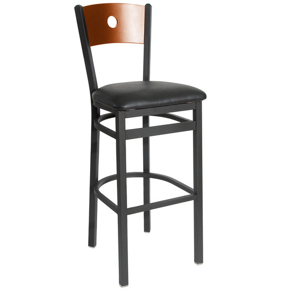 "BFM Seating 2152BBLV-CHSB Darby Sand Black Metal Bar Height Chair with Cherry Wooden Back and 2"" Black Vinyl Seat Main Image 1"