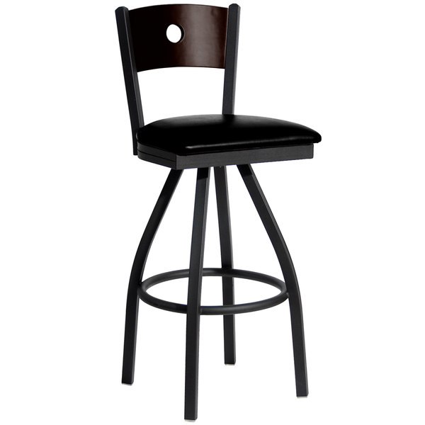 "BFM Seating 2152SBLV-WASB Darby Sand Black Metal Bar Height Chair with Walnut Wooden Back and 2"" Black Vinyl Swivel Seat Main Image 1"