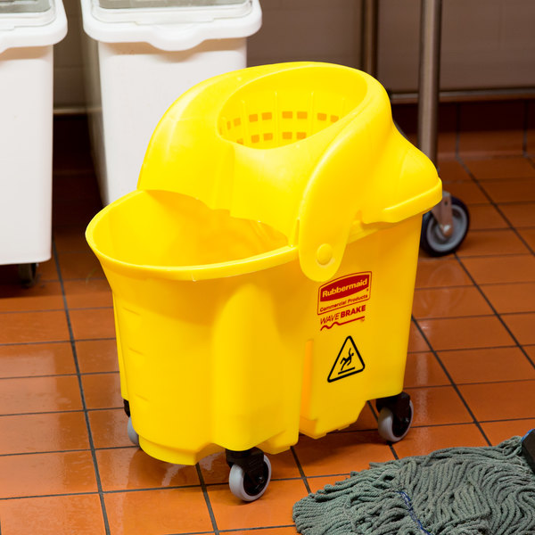 Rubbermaid FG759088YEL WaveBrake® 35 Qt. Yellow Institutional Mop Bucket with Sieve Wringer