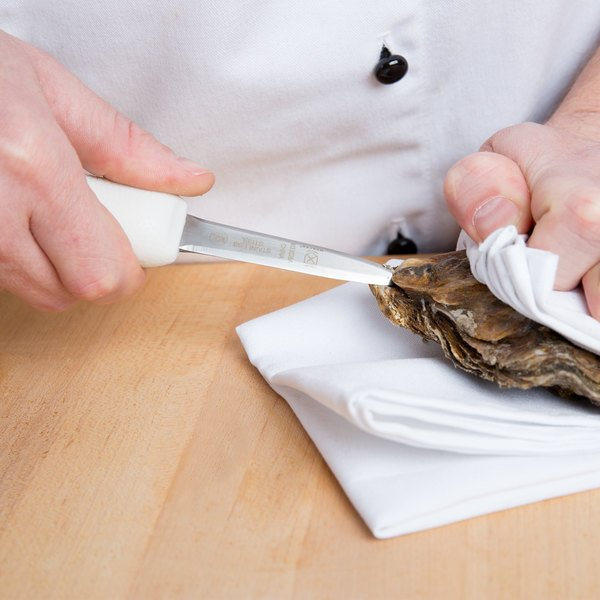 Inserting knife into oyster