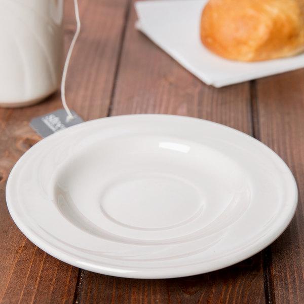 "Syracuse China 950038431 Cascade 5 3/4"" Ivory (American White) Round Medium Rim Flint Porcelain Tea Saucer - 36/Case"