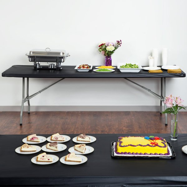 """Creative Converting 702000 Stay Put Black 30"""" x 96"""" Rectangular Plastic Tablecloth with Elastic - 12/Case Main Image 5"""
