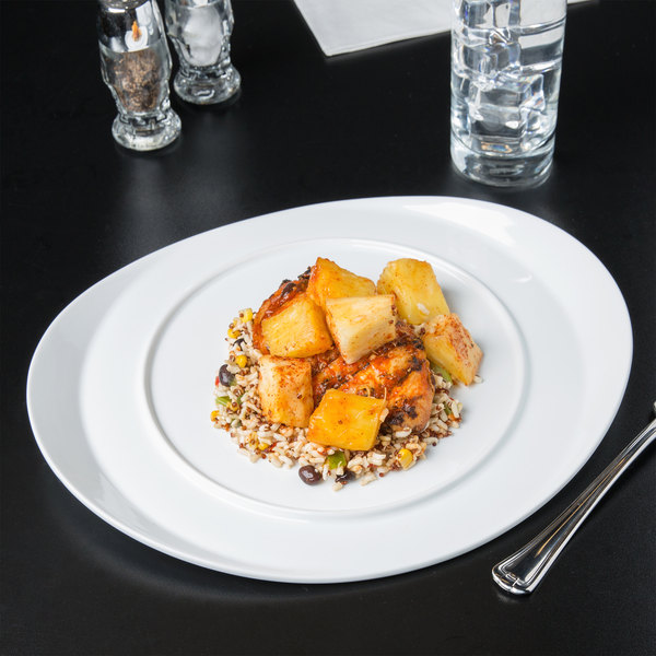 """World Tableware BW-6713 Chef's Selection II 13"""" x 11"""" Ultra Bright White Porcelain Monorail Plate - 12/Case"""
