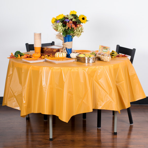 "Creative Converting 323379 82"" Pumpkin Spice Orange OctyRound Disposable Plastic Table Cover - 12/Case"