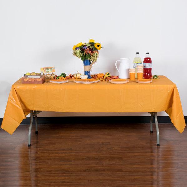 "Creative Converting 323400 54"" x 108"" Pumpkin Spice Orange Disposable Plastic Table Cover - 12/Case Main Image 3"