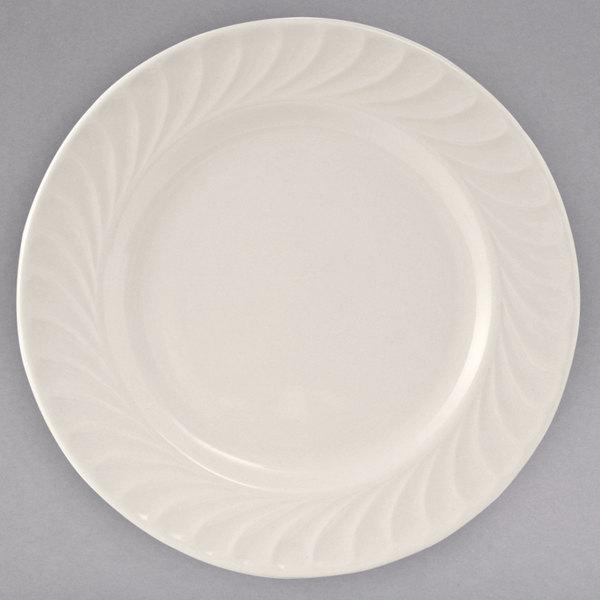 "Tuxton MEA-124 Meridian 12 1/2"" Ivory (American White) Swirl Rim China Plate - 12/Case"
