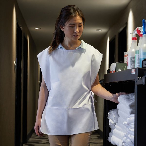 Woman grabbing towels from janitor cart wearing a white cobbler apron