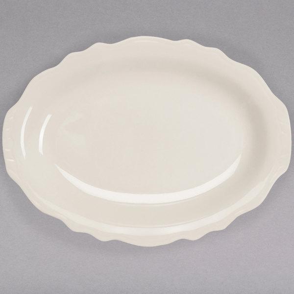 "Homer Laughlin by Steelite International HL52600 Carolyn 11 3/4"" x 8 5/8"" Ivory (American White) Scalloped Edge Oval Platter - 12/Case Main Image 1"
