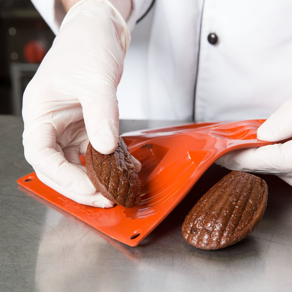 Brownies being removed from a silicone mold