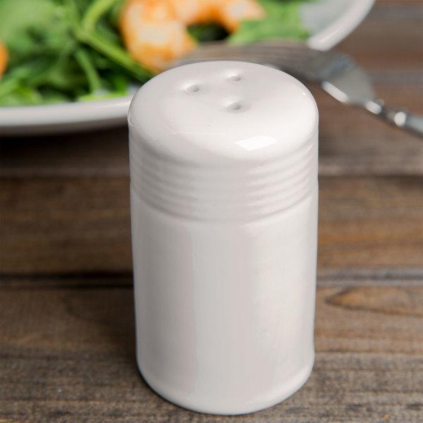 Tuxton BEI-0301 DuraTux 2 oz. Ivory (American White) China Pepper Shaker - 12/Case