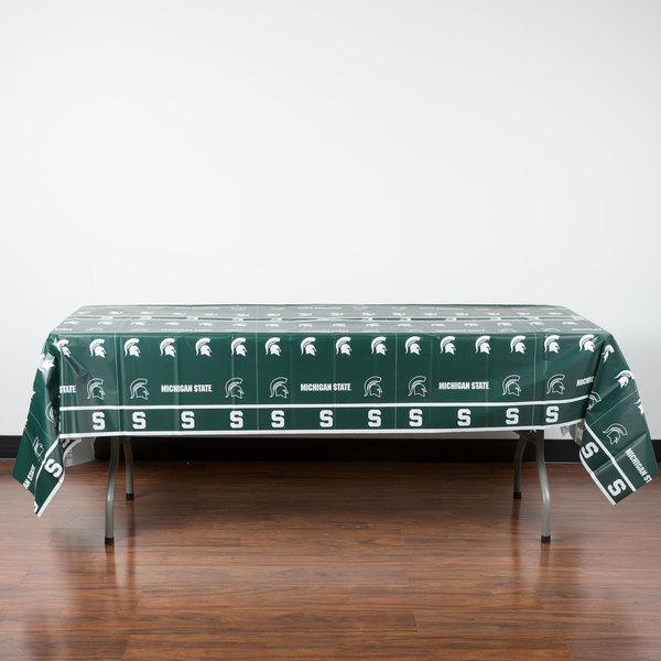 "Creative Converting 724716 54"" x 108"" Michigan State University Plastic Table Cover - 12/Case"