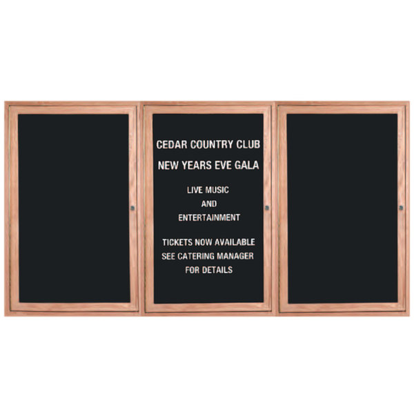 "Aarco ODC3672-3L 36"" x 72"" Red Oak Enclosed Wooden Indoor Message Center with Black Letter Board and 3/4"" Letters - 3 Hinged Locking Doors"