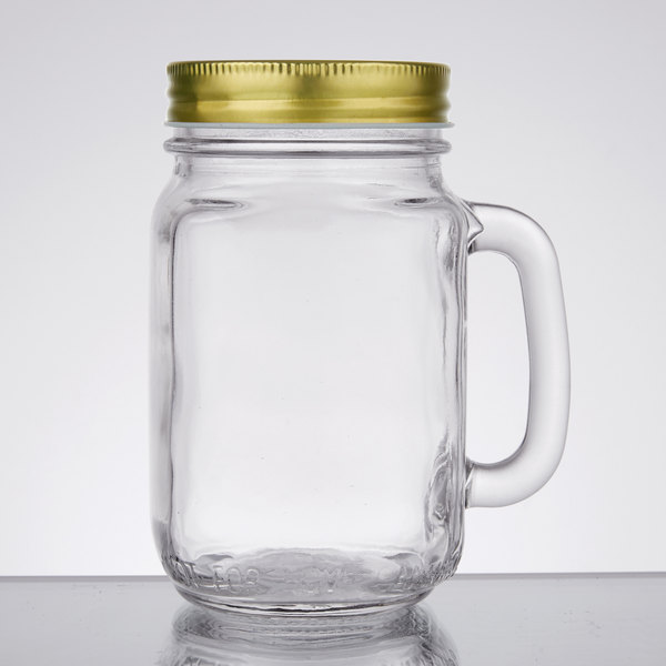 ball 16 oz mason jars. this core 16 oz mason jar with handle and gold metal lid adds a fun flair · ball jars