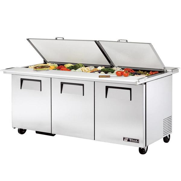 "True TSSU-72-30M-B-DS-ST 72"" 3 Door Mega Top Dual Sided Refrigerated Sandwich Prep Table"