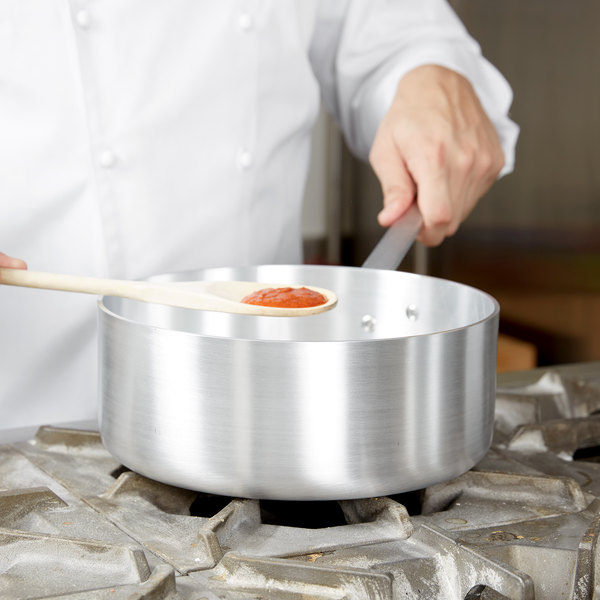 Vollrath Wear-Ever sauce pan with a spoon showing sauce raised above it