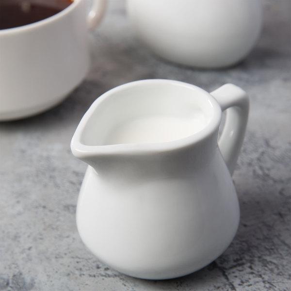 Acopa 3.5 oz. Bright White Porcelain Creamer - 48/Case Main Image 1