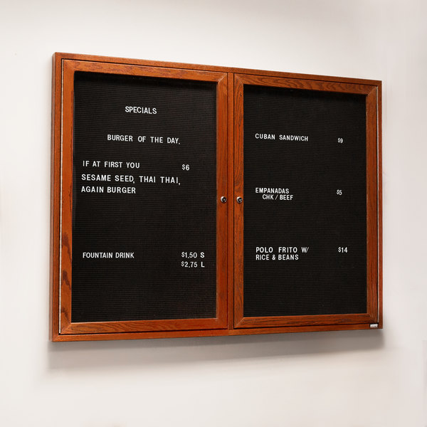 "Aarco CDC3648 36"" x 48"" Enclosed Indoor Hinged Locking 2 Door Black Felt Message Board with Cherry Frame"