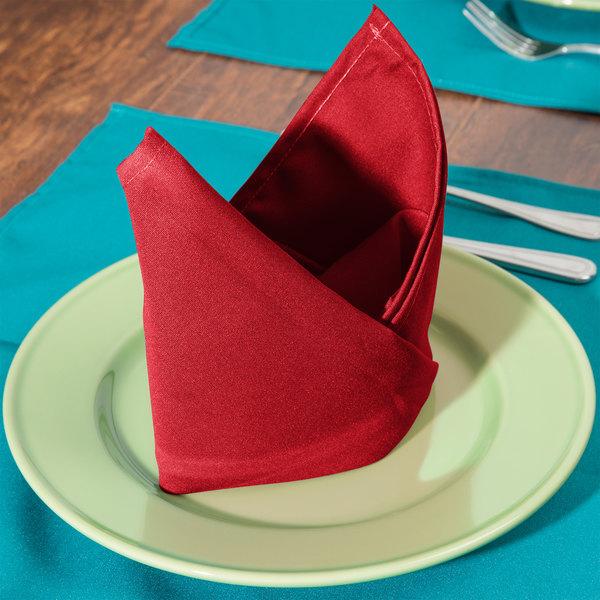 "22"" x 22"" Red Hemmed Polyspun Cloth Napkin - 12/Pack"