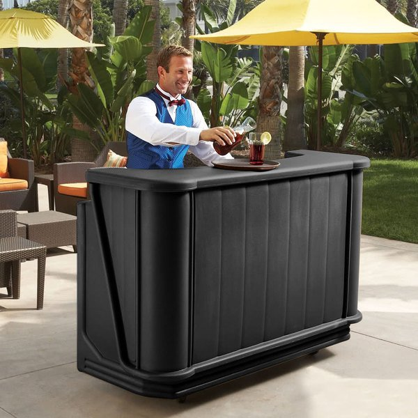 Black Cambro portable bar on a patio with a bartender standing behind