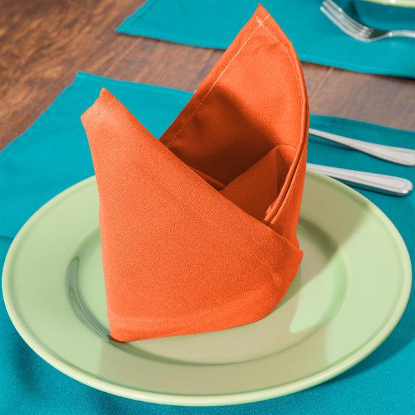 "22"" x 22"" Orange Hemmed Polyspun Cloth Napkin - 12/Pack"