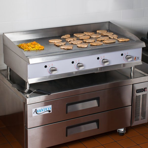 """Cooking Performance Group 48GTRBNL 48"""" Heavy-Duty Gas Countertop Griddle with Flame Failure Protection, Thermostatic Controls, and 2 Drawer Refrigerated Chef Base - 120,000 BTU"""