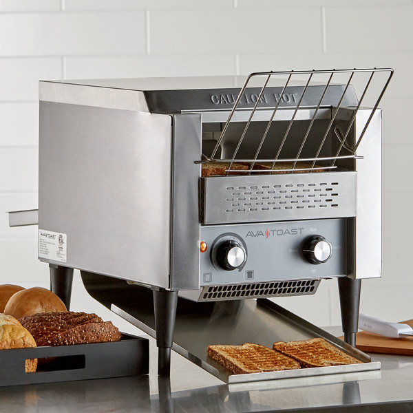 conveyor toaster on countertop with toast and bread basket