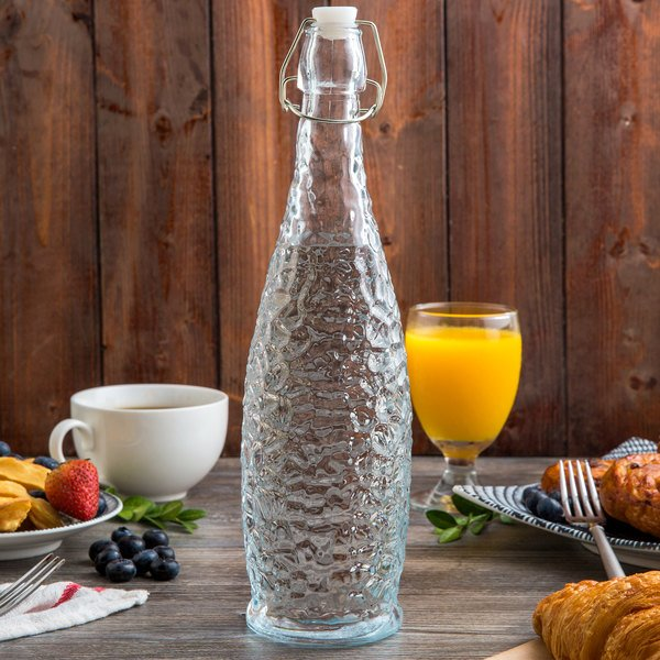Acopa 32 oz. Textured Glass Water Bottle with Clear Swing Top Lid - 6/Case