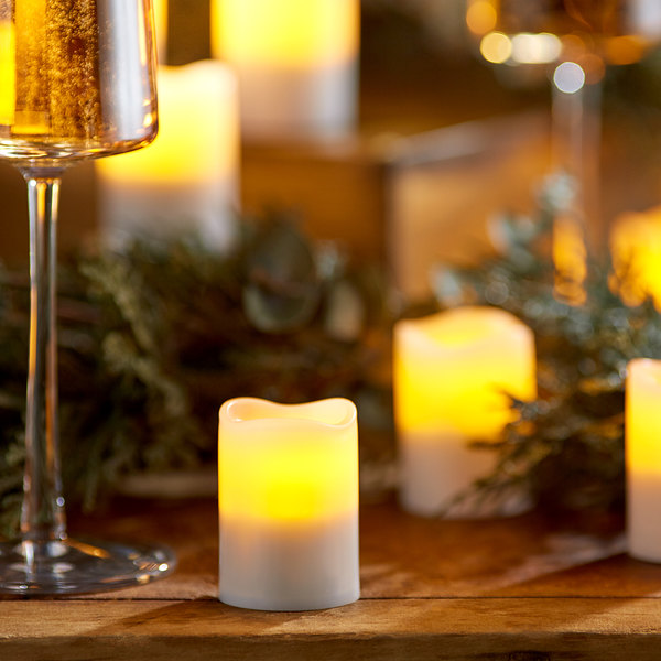 Sterno 60316 2.0 12 Piece Amber Rechargeable Flameless Votive Set with EasyStack Charging Base and Timer with Remote Main Image 3