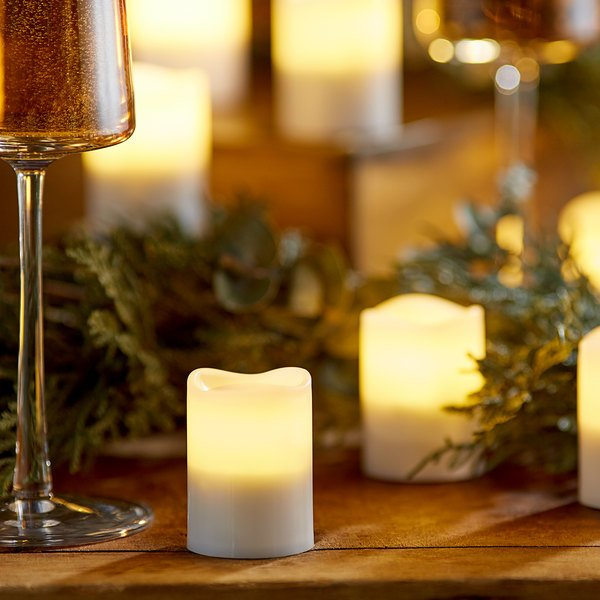 Sterno Products 60318 2.0 12 Piece Warm White Rechargeable Flameless Votive Set with EasyStack Charging Base and Timer with Remote