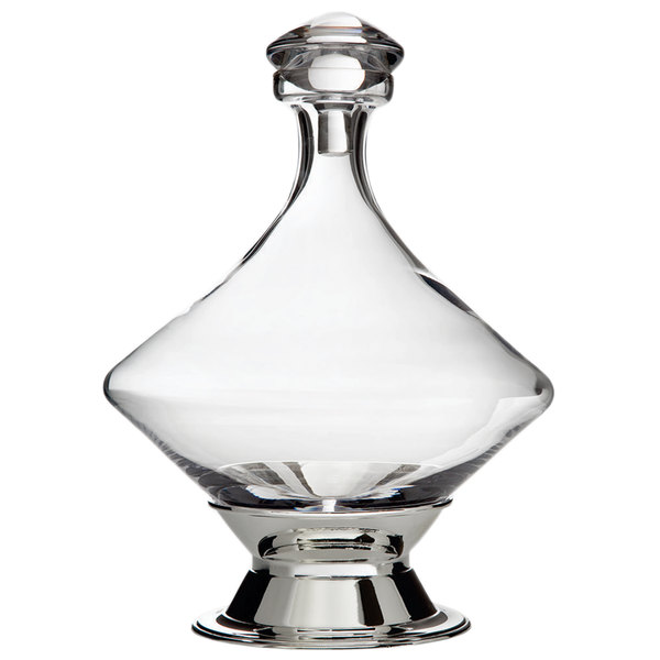 Crystal whiskey decanter beside two whiskey glasses