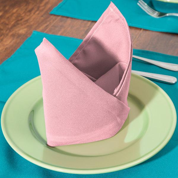 "18"" x 18"" Pink Hemmed Polyspun Cloth Napkin - 12/Pack"