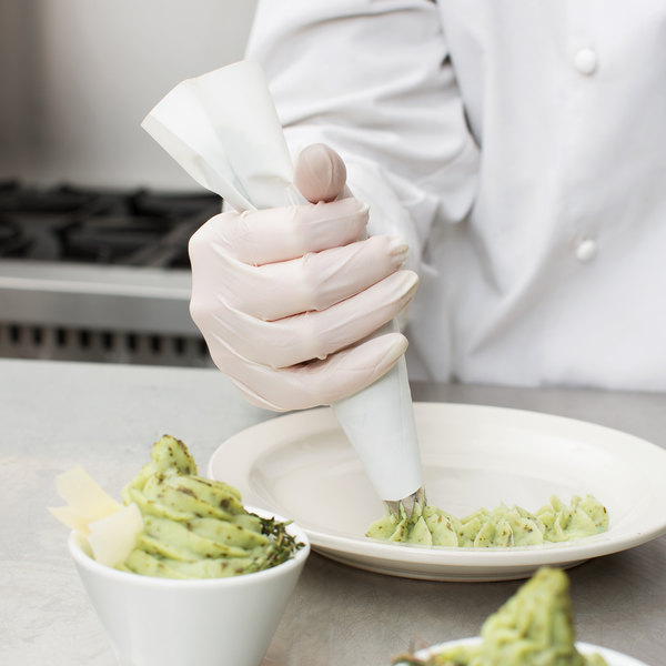 Chef using a polyester pastry bags to pipe mashed potatoes