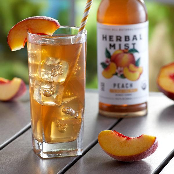 Herbal Mist 16.9 fl. oz. Sweetened Peach Iced Tea with Yerba Mate - 12/Case Main Image 2